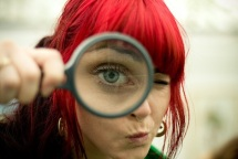 Woman and Magnifying Glass